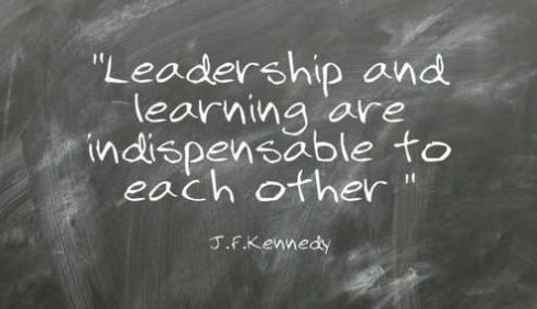 written on a chalk board it says, Leadership and learning are indispensable to each other - JFK